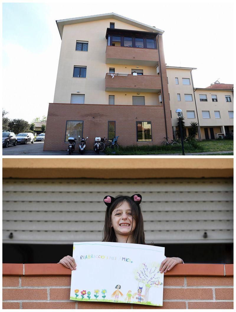 7-річна Аріанна Соррезін тримає малюнок на балконі в своєму будинку в місті Кастільоне-делла-Песка, Гроссето, Італія