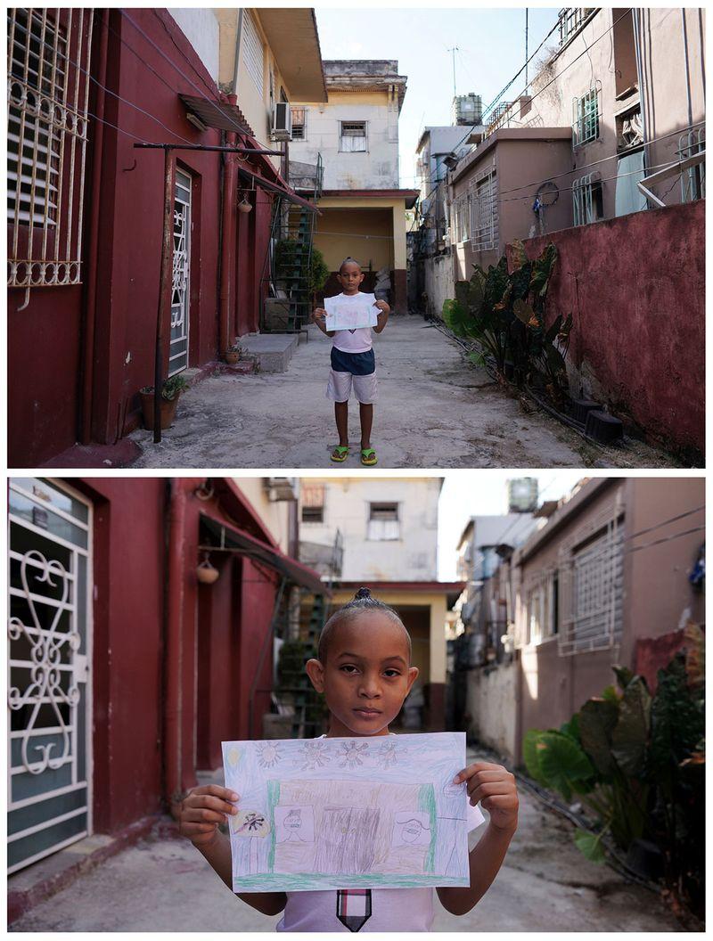 Крістофер Лукас Рейєс, 7 років, тримає малюнок перед своїм будинком у Гавані на Кубі.